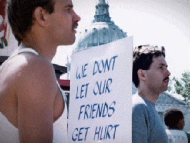 """Manif USA avec des pancartes """"We don't let our friends get hurt"""""""